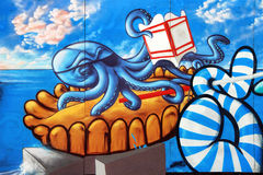 Sete  graffiti scene. SETE, FRANCE - August 23, 2014: Water Jousting graffiti representation with octopus on the wall of Sete, south of France on August 23, 2014 Stock Photography