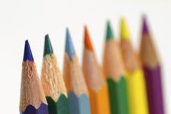 Sete lápis coloridos em seguido Fotografia de Stock