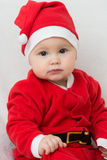 Sete meses de bebê idoso no vestido de Santa Claus Imagem de Stock Royalty Free