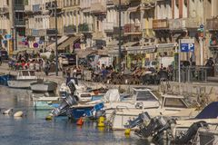 One sunny day along the waterfront in Sete France people enjoy lunch Royalty Free Stock Photography