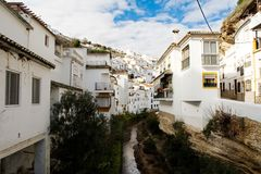 Setenil de las Bodegas, Spain. River crossing through Setenil de las Bodegas, a white hill town in Andalusia, Spain, Europe royalty free stock image