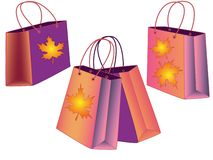 Seth gift bags. Set of autumn shopping bags. Bags in the autumn theme with golden leaves vector illustration