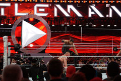 Seth Rollins curb stomps WWE Champion Brock Lesner face into the Stock Photo