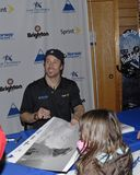 Seth Wescott siging autograph. Seth Wescott two-time gold medalist signing autograph for little girl at Sugarloaf stock image