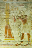 Seti praising the Djed Column, Abydos. Ancient Egyptian bas relief carving showing Pharaoh Seti I making an offering to the sacred Djed column.  Interior of Royalty Free Stock Image