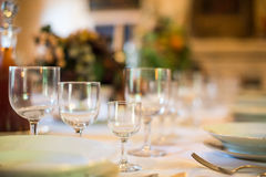 Setout table with tableware. Stock Images