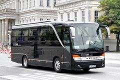 Setra S411HD. BERLIN, GERMANY - SEPTEMBER 10, 2013: Black Setra S411HD interurban coach at the city street Stock Photo
