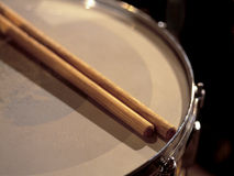 Between sets. Drumsticks resting on a snare drum between sets of a live show royalty free stock photos