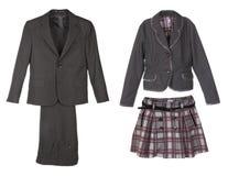 Sets av kläder för en pojke och en flicka på white Royaltyfri Bild
