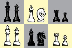 Sets of black and white chess with part of the chessboard Stock Image