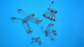 Sets of Brooch Pins. On Blue Background Royalty Free Stock Photos