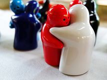 Colorful Hugging Dolls. Sets of Colorful Ceramic Hugging Dolls - Couples in Love Stock Images