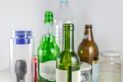 Sets of empty pot, bowl, glass bottles and plastic bottles with no label on a white background. Reuse, Eco-Friendly stock images