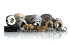 Sets of gears, cogwheels made of steel and brass isolated on white background with shadow reflection. Helical and spur gears,some stock photo