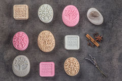 Sets of handmade ornamental soaps on black board, product of cosmetics or body care Stock Photography