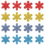 4 sets of 4 isolated snowflakes. In different colors Stock Photos
