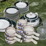 Sets of plates, dishes, soup bowls at garage sale Royalty Free Stock Photos