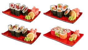 Sets of sushi rolls in red plates. On a white background stock images