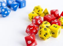 Sets of yellow, blue and red dices for rpg, dnd or board games on white background. Closeup Stock Image