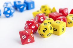Sets of yellow, blue and red dices for rpg, dnd or board games on white background. Closeup Stock Images