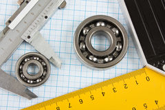 Setsquare and calliper with bearing Royalty Free Stock Image
