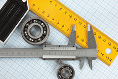 Setsquare and calliper with bearing Royalty Free Stock Photography