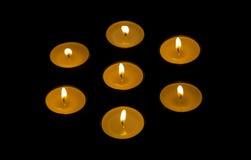Sette candele Fotografie Stock Libere da Diritti