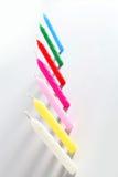 Sette candele colorate Immagine Stock