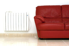 Settee and central heat radiator Stock Photos