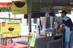 27 settembre 2016, il Malacca, Malesia La scossa della noce di cocco di Klebang era al giorno d'oggi la bevanda più calda in mela Fotografie Stock Libere da Diritti