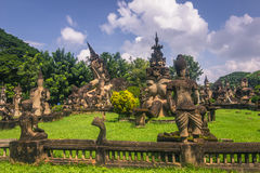 26 settembre 2014: Le statue di pietra buddisti in Buddha parcheggiano, il Laos Immagine Stock Libera da Diritti