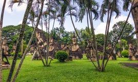 26 settembre 2014: Le statue di pietra buddisti in Buddha parcheggiano, il Laos Immagini Stock Libere da Diritti
