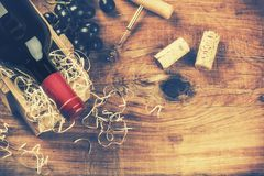 Setting with bottle of red wine, grape and corks. Wine list concept stock photography