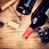 Setting with bottle of red wine, grape and corks. Wine list conc Royalty Free Stock Image