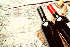 Setting with bottles of red wine and corks. Wine list concept. With copy space Stock Images