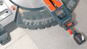 Setting cut angle of miter saw. Man sets the cut angle of miter saw stock video
