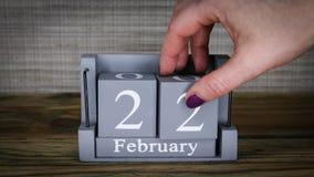 22 calendar February months. 22 setting date on wooden cube calendar for February months stock video footage