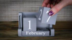17 calendar February months. 17 setting date on wooden cube calendar for February months stock video
