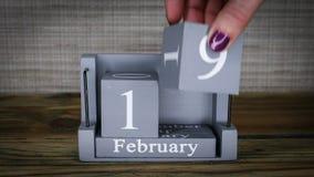 19 calendar February months. 19 setting date on wooden cube calendar for February months stock video