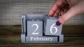 26 calendar February months. 26 setting date on wooden cube calendar for February months stock video footage
