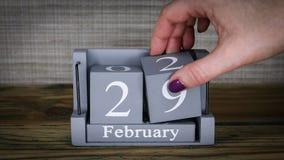 29 calendar February months. 29 setting date on wooden cube calendar for February months stock video