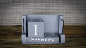 16 calendar February months. 16 setting date on wooden cube calendar for February months stock video