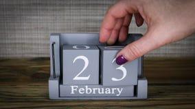 23 calendar February months. 23 setting date on wooden cube calendar for February months stock footage