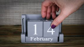14 calendar February months. 14 setting date on wooden cube calendar for February months. Valentine`s day stock footage