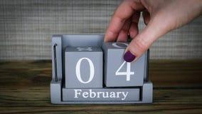 04 calendar February months. 04 setting date on wooden cube calendar for February months. World Cancer Day stock video