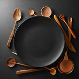 Setting empty plate and wooden cutlery Royalty Free Stock Photography