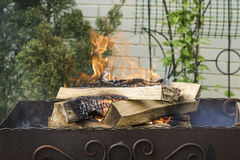 Setting fire for bbq Stock Image