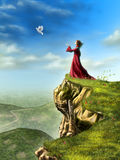 Setting free. A dove is set free to fly by a woman standing on a cliff. Digital illustration Stock Photos