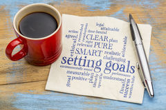 Setting goals word cloud on napkin Royalty Free Stock Photography