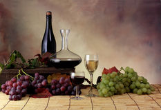 Setting with grape and wine. With bottle and glasses Royalty Free Stock Photos